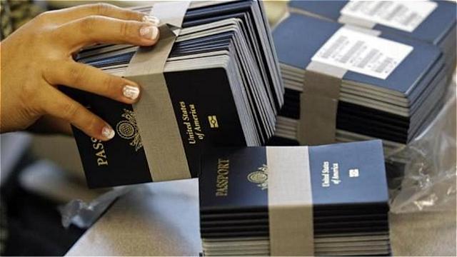 新法规定 欠税5万扣护照